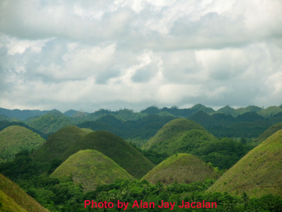 a beautiful sky and scenary of chocolate hills